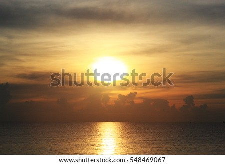 Sunset on the beach and golden sky - Shutterstock ID 548469067