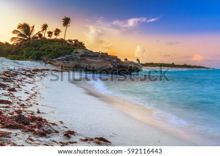 Shutterstock Sunset on the beach of Playa del Carmen at caribbean sea, Mexico
