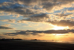 Sunset on the beach of St Malo (Brittany France).