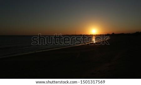 Sunset on the beach. Orange sunset sea. Sunset sea horizon panorama lanscape