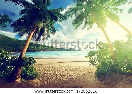 Stock Photo sunset on the beach Takamaka, Mahe island, Seychelles