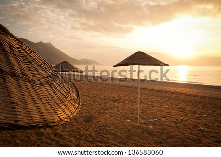 sunset on the beach under an umbrella