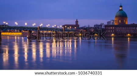 Sunset on the bridge over the Garonne river in Toulouse (France) #1036740331