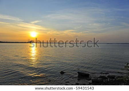 Sunset on the Chesapeake Bay, Maryland with factory and Key bridge