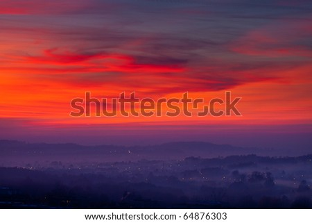 Sunset on the city background - stock photo