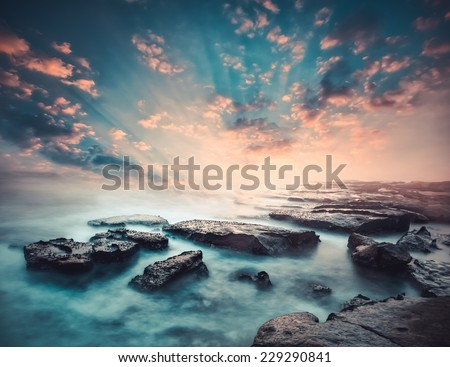 Sunset on the coast of the Sri Lanka at dawn with rocks in foreground #229290841
