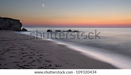 sunset on the deserted beach in the Crimea