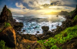 Sunset on the horizon in a sea bay in the mountains. Sea bay at sunset. Sunset sea bay landscape. Coastal landscape at sunset