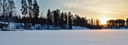 Sunset on the lake in Finland in the winter