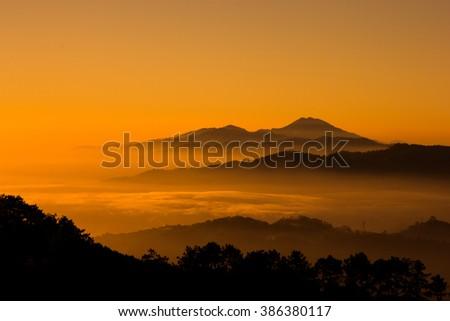 sunset on the mountain #386380117