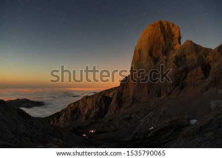 sunset on the peaks of europe against the orange tree of bulens or peak urriellu