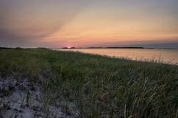 Sunset on the sandy beach Shallow Bay, Cow Head, Gros Morne National Park, Newfoundland & Labrador