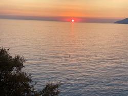 sunset on the sea surface. The sun sets, the sea glistens. turkish coast