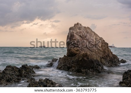 Sunset on the sea with Rocks stone #363793775