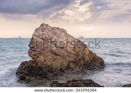 Sunset on the sea with Rocks stone #365996384