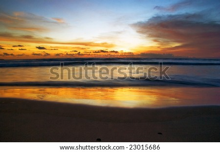 Sunset on the tropical beach. Legian beach on Bali island. Indonesia - stock photo