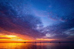 Sunset or sunrise in ocean or sea, nature landscape background. Sunset sea beach. Blue sea and reflection of sunlight