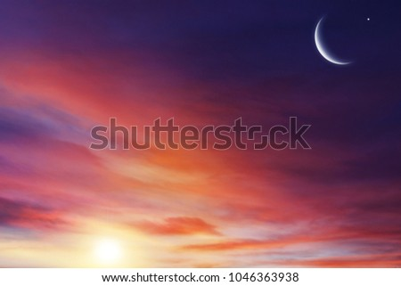 Sunset or sunrise with clouds . Red sunset and moon .  beautiful sky  . Prayer time . Generous Ramadan . Mubarak background .  #1046363938