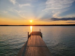 Sunset over a dock on Child's Lake in Duck Mountain Provincial Park, Manitoba, Canada