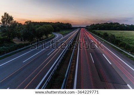 sunset over a german highway #364229771