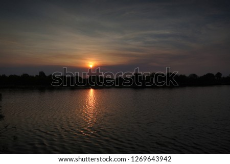 Sunset over a lake #1269643942