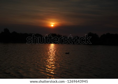 Sunset over a lake #1269643945