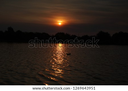 Sunset over a lake #1269643951