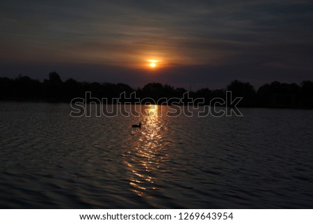 Sunset over a lake #1269643954