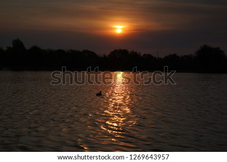 Sunset over a lake #1269643957