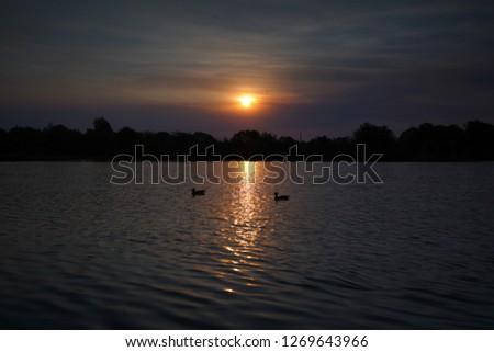 Sunset over a lake #1269643966