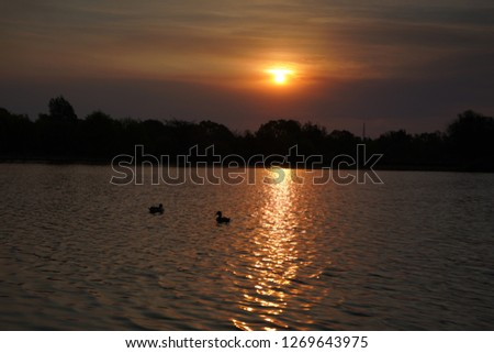 Sunset over a lake #1269643975