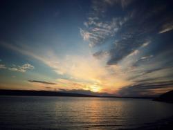 Sunset over a lake in gander newfoundland.