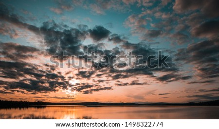 Sunset over a lake in Northern Sweden #1498322774