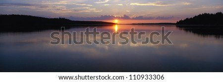 Sunset over a lake, Sweden - stock photo