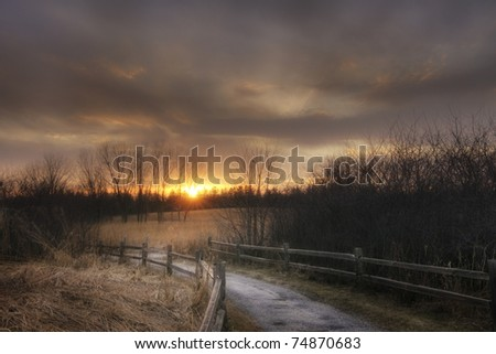 Sunset over a meadow in American Midwest
