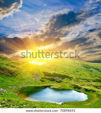 sunset over a mountain valley