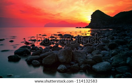 sunset over a rocky coast