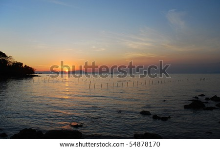 Sunset over a rocky coastline at Rabbit Island, Cambodia