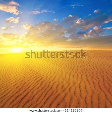 sunset over a sand desert