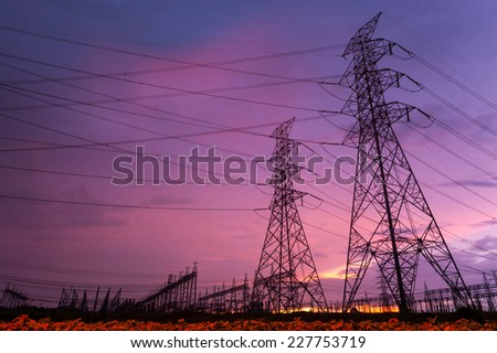 Sunset over a Silhouette electrical substation