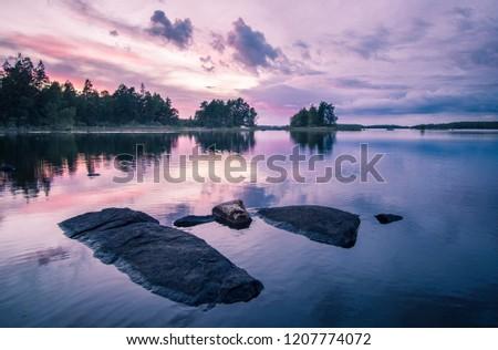 Sunset over a swedish lake #1207774072