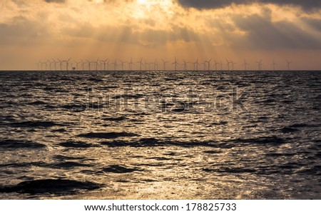 Sunset over an offshore wind power station in the Baltic Sea