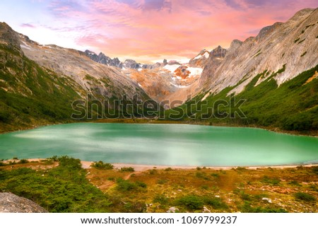 Sunset over Andes mountains and lake Laguna Esmeralda near Ushuaia in Tierra del Fuego, Argentina