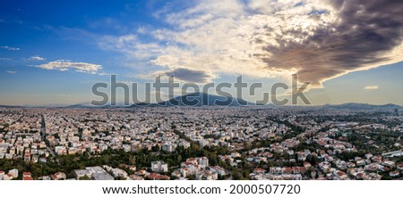 Sunset over Athens, Greece. Aerial drone panoramic view from Penteli mount. Last sunbeams over Greek capital background. Destination Athens, where sunrays caress, heat up people and hearts, banner. Foto stock ©