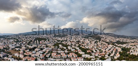 Sunset over Athens, Greece. Aerial drone panoramic view from Penteli mount. Last sunbeams over Greek capital city. Destination Athens, where sunrays caress, heat up people and hearts, banner. Foto stock ©