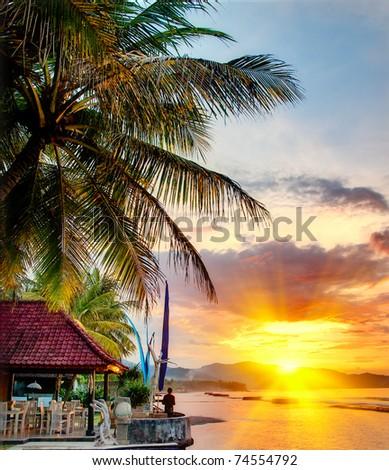 Sunset over Balinese coastline - stock photo
