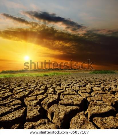 sunset over barren land