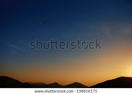 Sunset over blue dark night sky with many stars. Space background