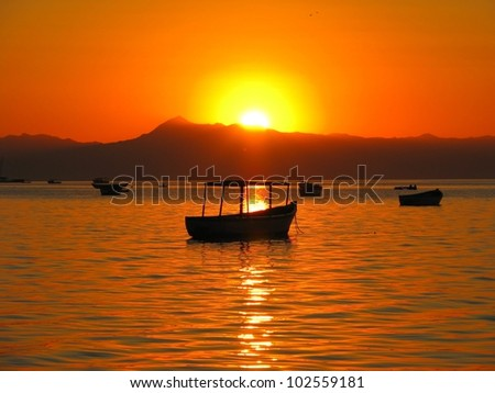 Sunset over boats on Lake Malawi, Cape Maclear, Malawi