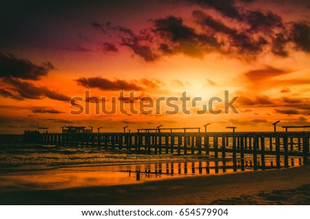 Stock Photo Sunset over Bridge at sea time in beautiful day amazing sunrise